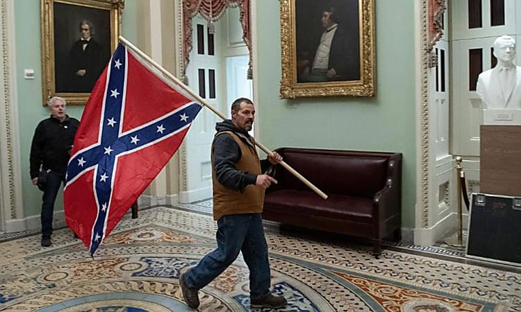 The FBI wants your help in ID'ing the man carrying a Confederate flag inside the US Capitol