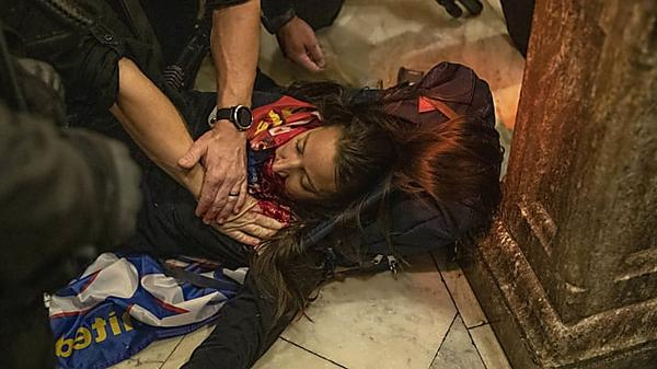 Woman shot during chaotic protests in US Capitol has died