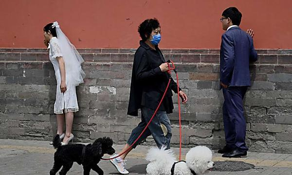 Divorces fall 70% in China after government orders couples to cool off